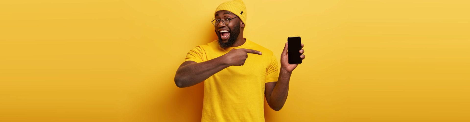 a man pointing at his phone